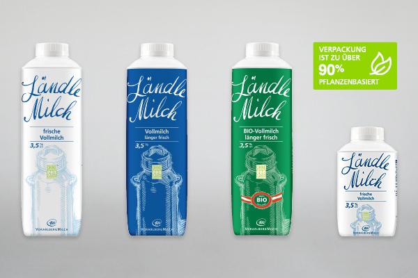 Vier unterschiedliche Vorarlberg-Milch-Tetra-Packs auf grauem Hintergrund