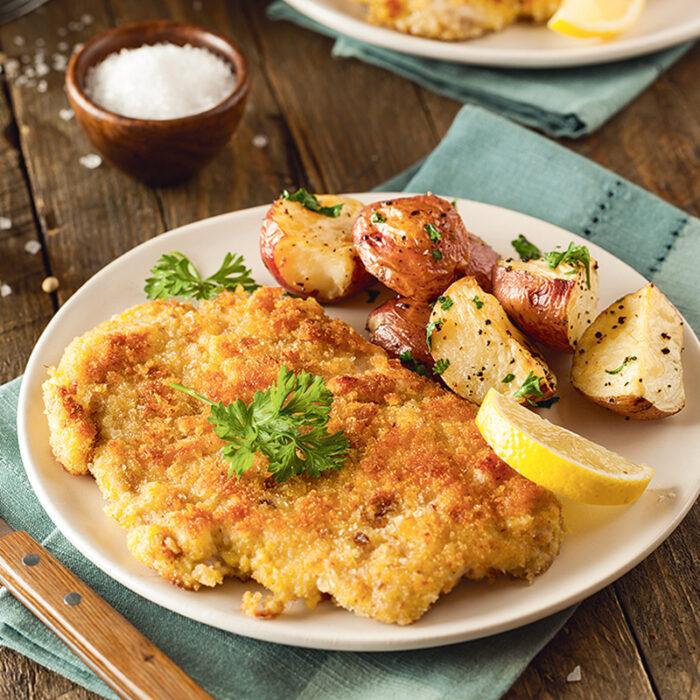 Wiener Schnitzel mit Kartoffel-Wedges Bild: Gettyimages